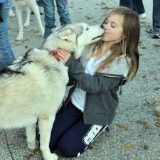 A Girl Scout gets a kiss from Acadia