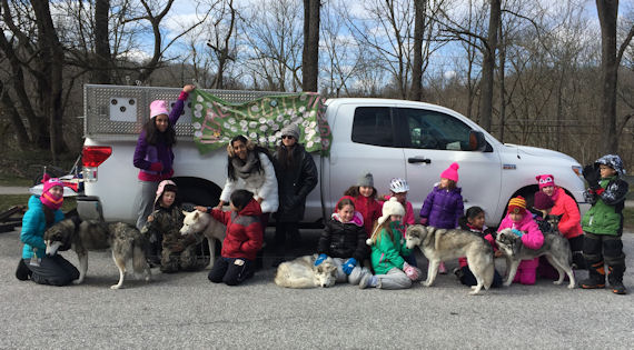 Happy scouts and sled dogs after a day on the trail